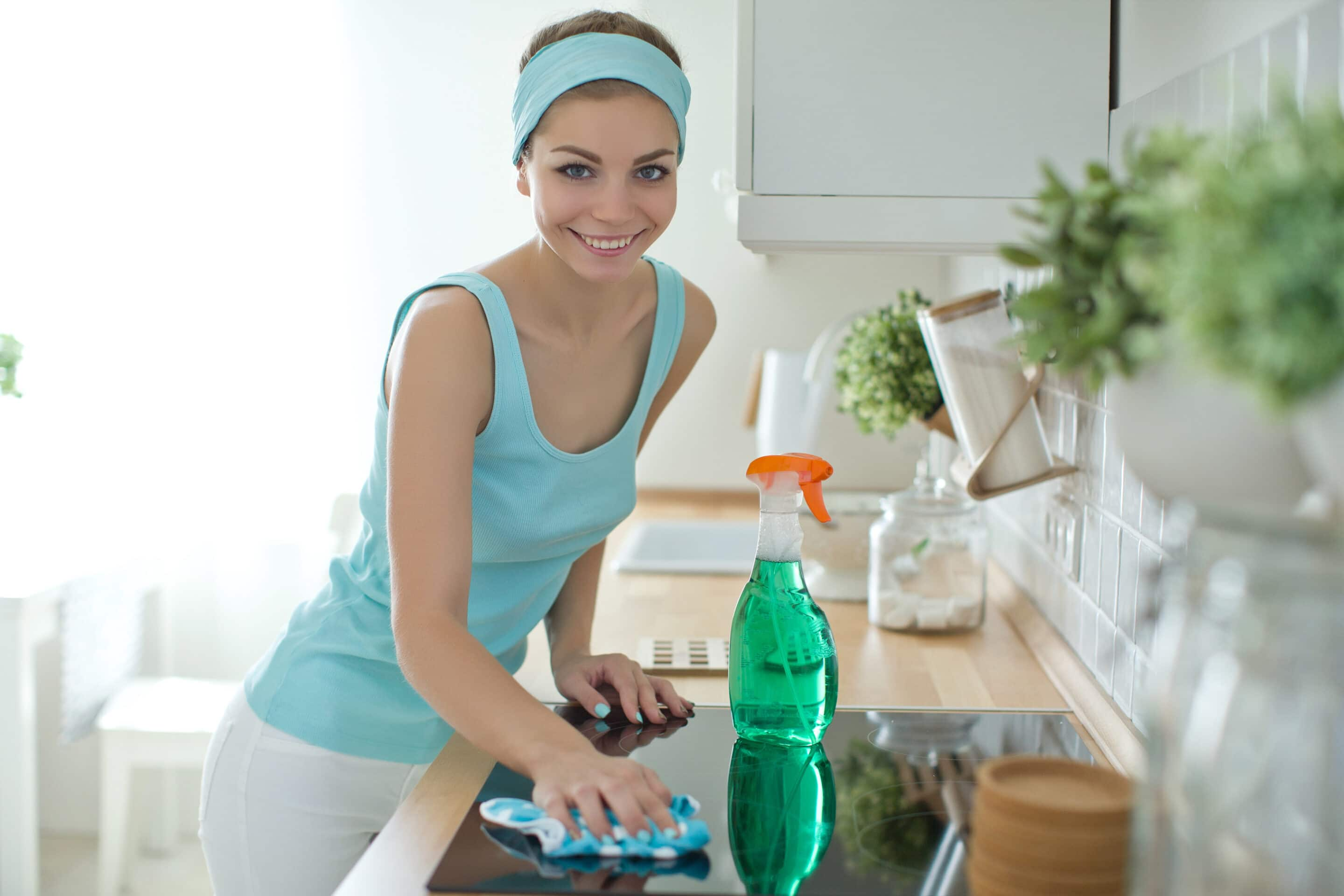 House Cleaning Lady polishing stove top